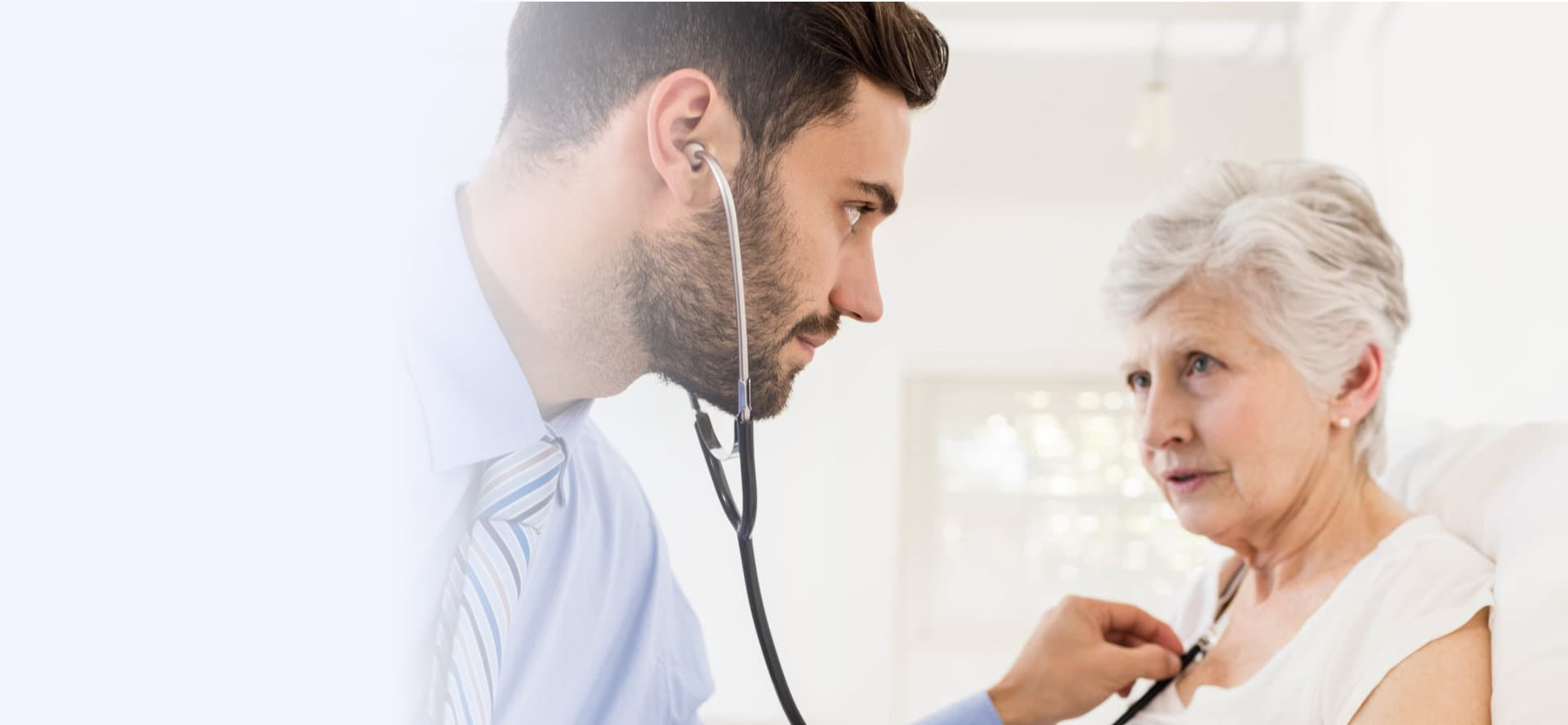 doctor consulting with elder woman