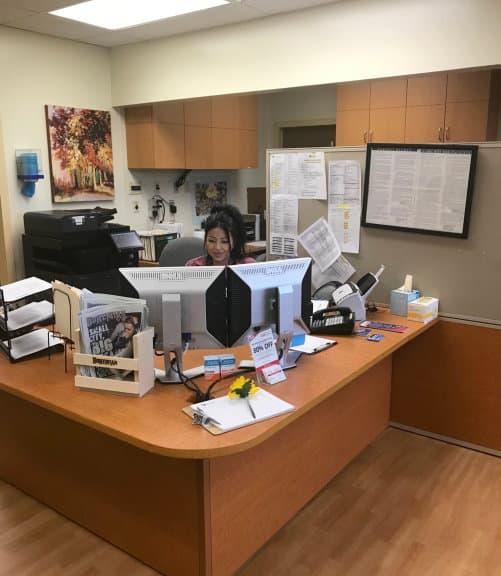 nurse in her desk